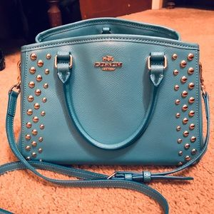 Coach cross body, turquoise with gold accents.
